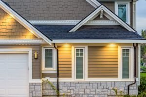 Beige siding paired with a black roof