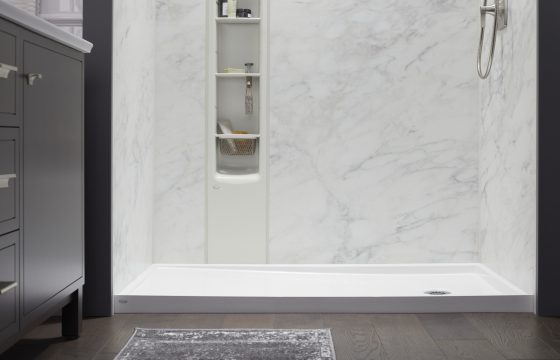 close up shot of the luxstone calacutta shower locker and shower base