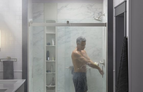 man in his kohler luxstone calacutta shower, washing his arms - looks relaxing!