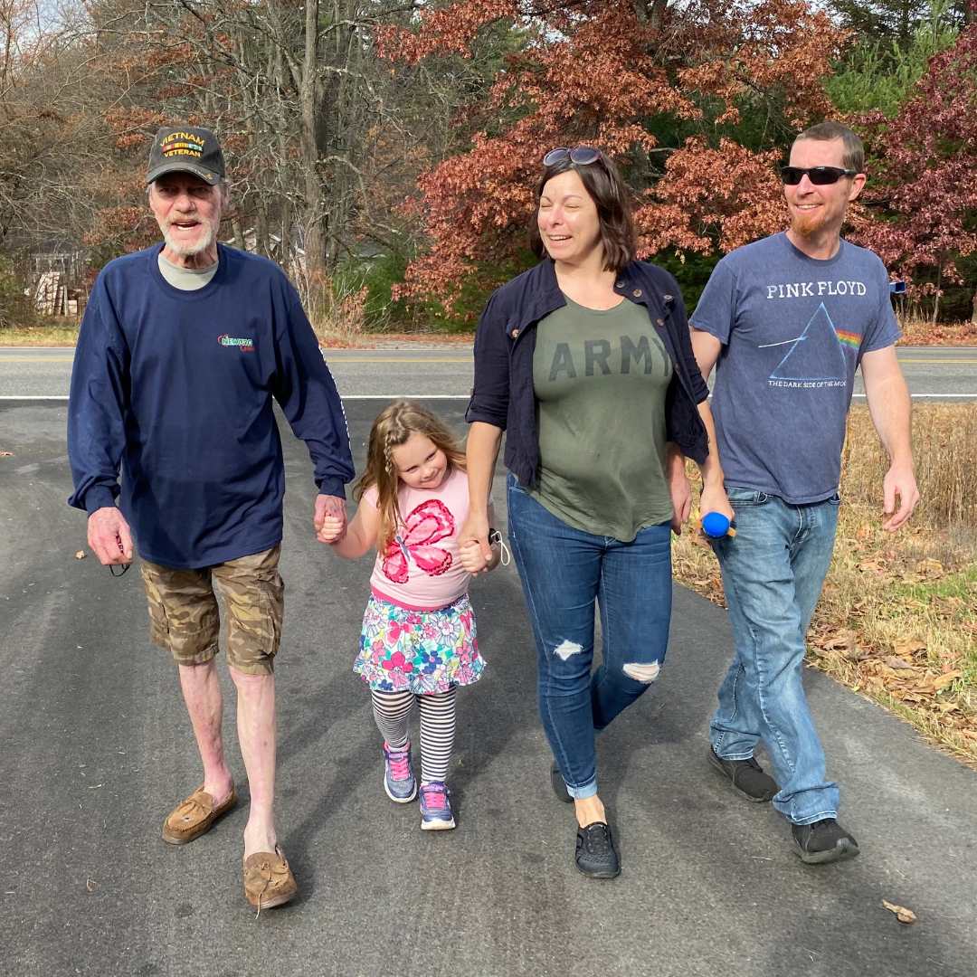 Baths for the Brave recipient walks with his family