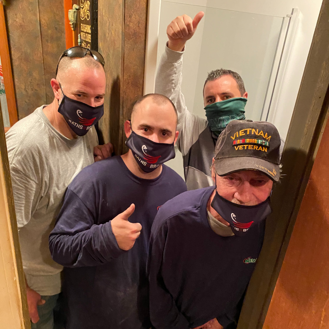 Baths for the Brave recipient takes in-home photo with NEWPRO staff